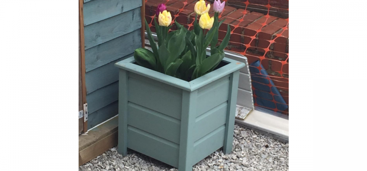 Learn how to upcycle old pallets into a garden planter by following these simple steps